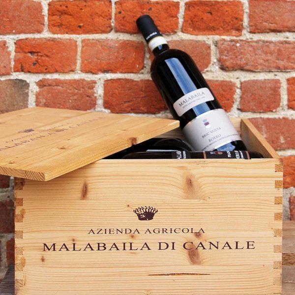"""Cassetta in legno """"Malabaila"""" con sei bottiglie."""